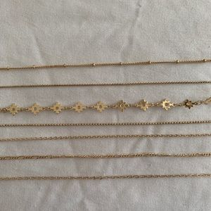set of 7 gold bracelets